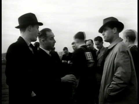dramatization 'lt roberts and inspector finch' on field talking w/ english police instructor students in identification training bg ms car pulling up... - 1949 stock videos and b-roll footage