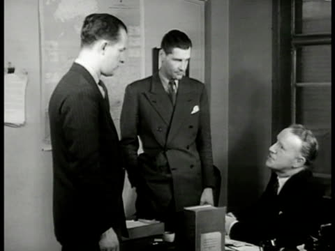 ms 'lt roberts' 'inspector finch' and 'superintendent morton' talking in office 'take over this shooting job would you like to go w/ him mr roberts' - 1949 stock videos and b-roll footage