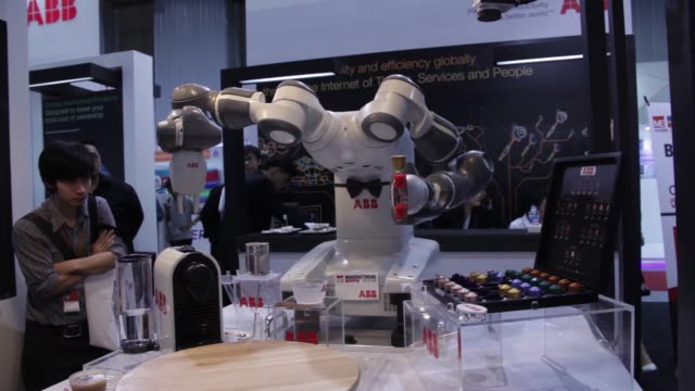 ABB Ltd's robotic barista known as YuMi® prepares a cappuccino using a Nespresso coffee machine during the Manufacturing Expo 2016 at the Bangkok...