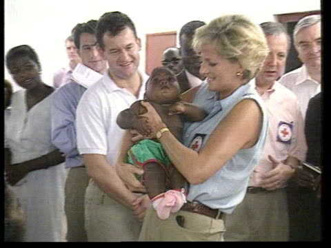 Luanda MS Princess Diana holding baby as her then butler Paul Burrell looks on