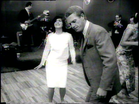 Luci Baines Johnson dances with Steve McQueen at a fundraiser for her father Lyndon Johnson's presidential campaign in Beverly Hills