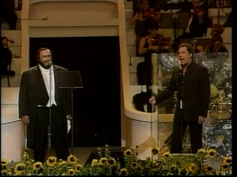 luciano pavarotti performing on stage in charity concert with tom jones pull out as they sing 'delilah' cms pavarotti cms tom jones singing pavarotti... - luciano pavarotti stock videos & royalty-free footage