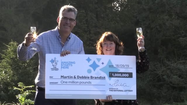 a lucky couple have received the perfect first wedding anniversary gift after winning £1 million on the lottery martin brandist and 48yearold wife... - millionnaire stock videos & royalty-free footage