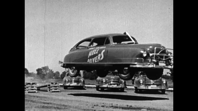 /Lucky Lee Lott and his Hell Drivers crash through a burning wall send a 1941 Nash rolling end over end do a backwards skid and turnaround and send a...