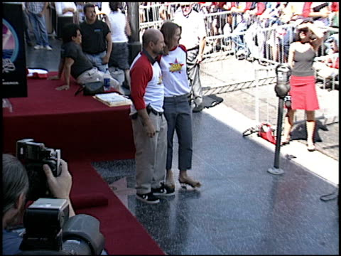 Lucy Lawless at the Dediction of David Spade's Walk of Fame Star at the Hollywood Walk of Fame in Hollywood California on September 5 2003