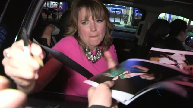 Lucy Lawless greets fans while departing West Hollywood 01/22/13