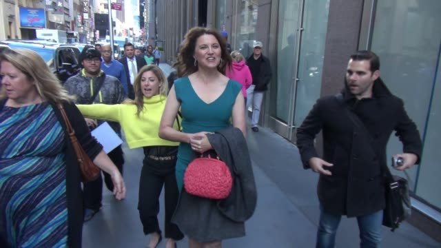 Lucy Lawless leaving SiriusXM Satellite Radio poses for photos with fans in New York City on October 26 2015 in New York City