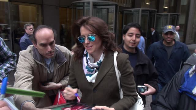 Lucy Lawless leaving SiriusXM Satellite Radio signs for fans while walking to her car Celebrity Sightings in New York on April 14 2015 in New York...