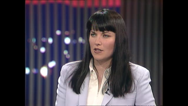 Lucy Lawless speaking about being considered beautiful and famous and the contrast with her private life during interview with host Susan Wood in 1997