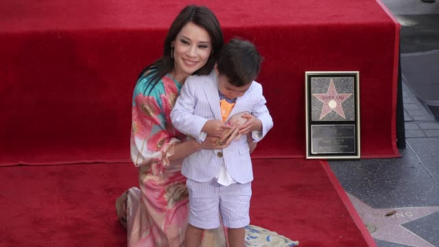 lucy liu and rockwell lloyd at the lucy liu honored with a star on the hollywood walk of fame on may 01, 2019 in hollywood, california. - lucy liu stock videos & royalty-free footage