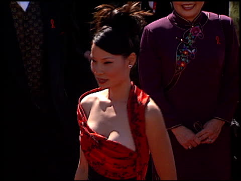 lucy liu at the 1999 emmy awards at the shrine auditorium in los angeles, california on september 12, 1999. - lucy liu stock videos & royalty-free footage