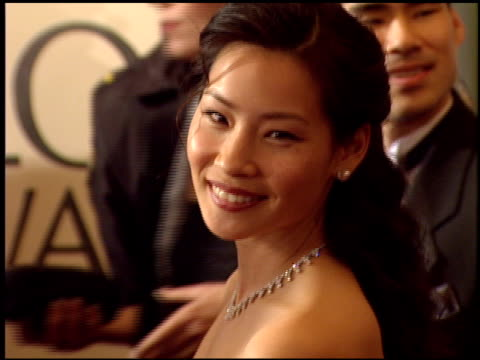 lucy liu at the 1999 golden globe awards at the beverly hilton in beverly hills, california on january 24, 1999. - lucy liu stock videos & royalty-free footage