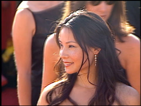 lucy liu at the 2000 emmy awards at the shrine auditorium in los angeles, california on september 10, 2000. - lucy liu stock videos & royalty-free footage