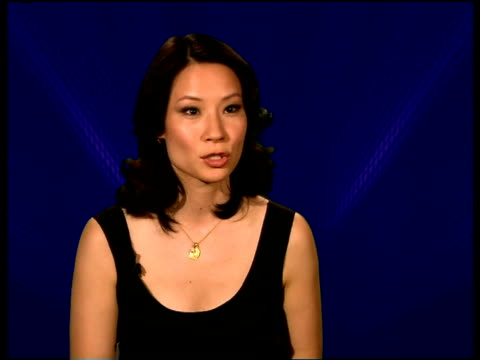 lucy liu interview; location unknown int lucy liu interview sot - on the difference between television and film roles / [on the possibility of... - lucy liu stock videos & royalty-free footage