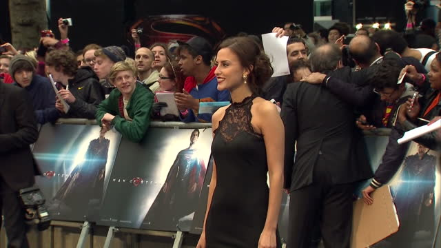 vídeos y material grabado en eventos de stock de lucy watson posing for photo op on red carpet of new superman film man of steel lucy watson at man of steel premiere at leicester square on june 12... - superman superhéroe