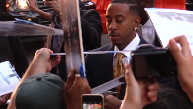 ludacris greets fans at the furious 7 premiere in hollywood in celebrity sightings in los angeles - ludacris stock videos & royalty-free footage