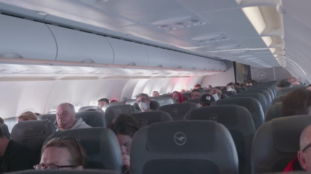 lufthansa airplane operating during the corona outbreak on a flight from stockholm to frankfurt - schweden stock-videos und b-roll-filmmaterial