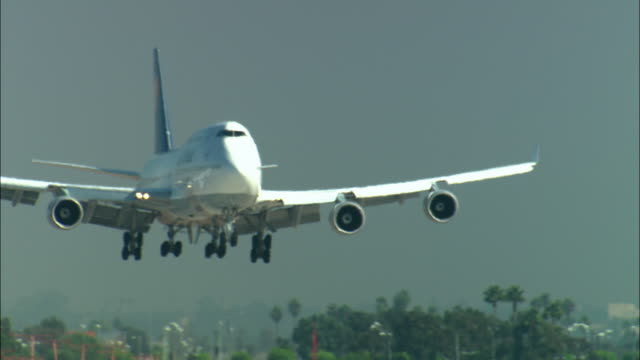 MS, Lufthansa passenger jet landing on runway, Los Angeles, California, USA