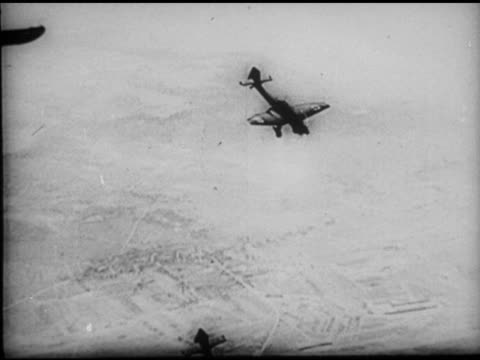 luftwaffe junkers ju87 'stuka' dive bombers in flight diving pov in aircraft diving toward land smoke ws silhouette 'stuka' bomber descending... - bomber stock videos and b-roll footage