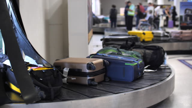 luggage at airport - collection stock videos & royalty-free footage