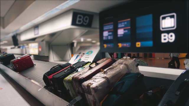 luggage belt at airport - baggage claim stock videos and b-roll footage
