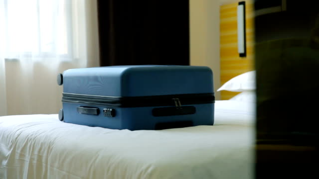 luggage on a hotel bed - hotel stock videos & royalty-free footage