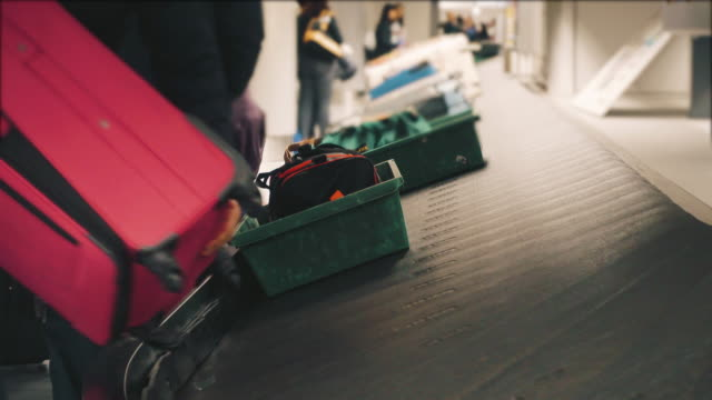 Luggage on baggage claim in the airport.