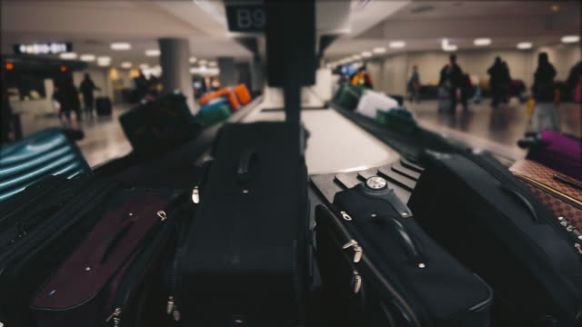 luggage on baggage claim in the airport. - bagaglio video stock e b–roll