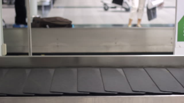 luggage on baggage conveyor belt at airport