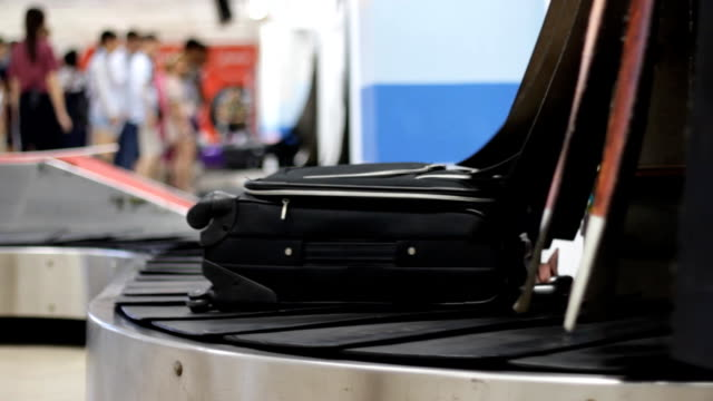 luggage on baggage conveyor belt at airport - moving past stock videos & royalty-free footage