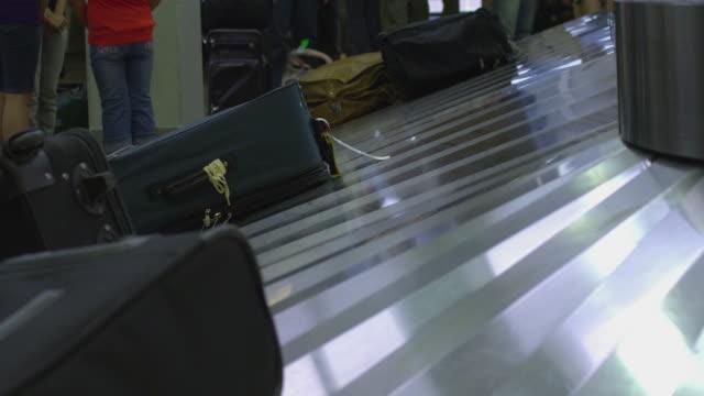 CU Luggage on conveyor belt at Salt Lake International Airport baggage claim / Salt Lake City, Utah, USA