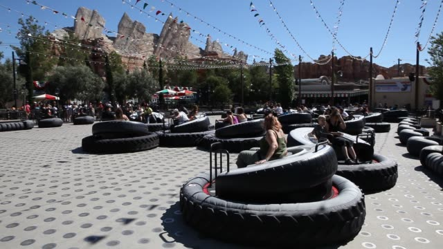 luigi's flying tires at cars land at disney california adventure park which is part of the entertainment resort disneyland in anaheim california in... - anaheim california stock videos & royalty-free footage