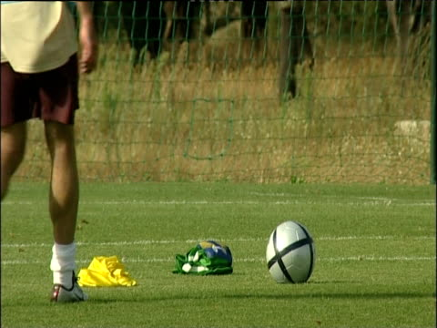 luis figo places football on ground practices free kick and scores goal as keeper dives for ball during portugal training session 10 jun 04 - bbc stock videos & royalty-free footage