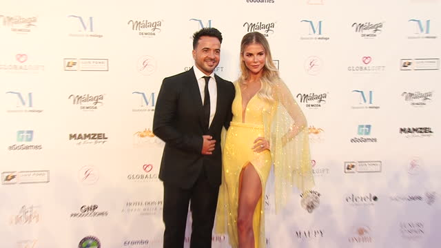 luis fonsi and aguedalopez attend the global gift gala 2021 red carpet at marbella arena auditorium - アゲダ・ロペス点の映像素材/bロール