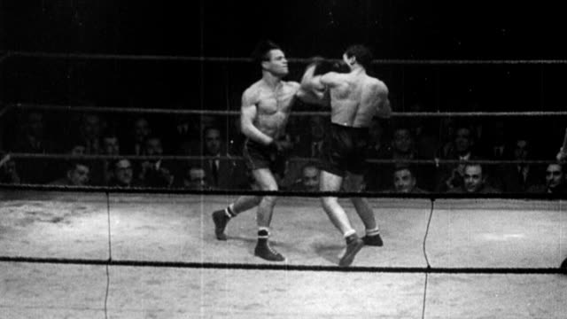 luis romero, spain's feather-weight champ, is defeated by challenger, luis de santiago / spectators watching boxing match between two men / romero... - 1949 stock videos & royalty-free footage