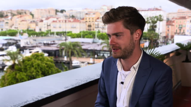 lukas dhont on showing the film to his transgender friends at 'girl' interviews - the 71st annual cannes film festival on may 13, 2018 in cannes,... - 第71回カンヌ国際映画祭点の映像素材/bロール