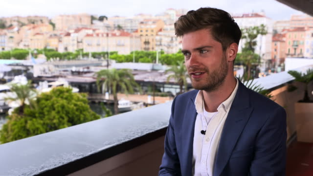 lukas dhont on the experience of cannes at 'girl' interviews - the 71st annual cannes film festival on may 13, 2018 in cannes, france. - 第71回カンヌ国際映画祭点の映像素材/bロール