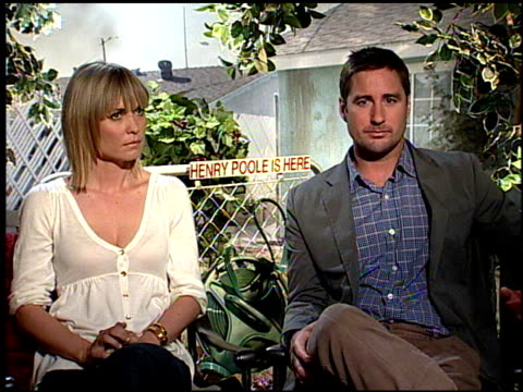 Luke Wilson and Radha Mitchell on the symbolism of the film taking place in real life at the HENRY POOLE IS HERE junket at Los Angeles CA