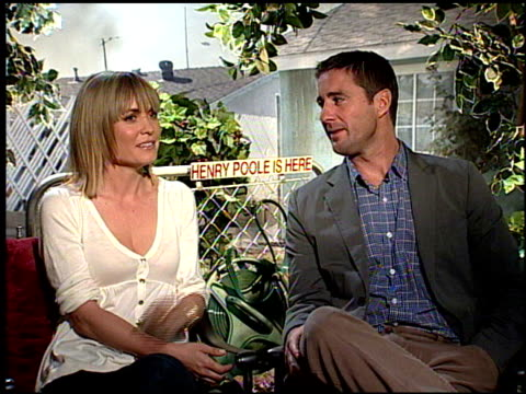 Luke Wilson and Radha Mitchell on their characters in the film at the HENRY POOLE IS HERE junket at Los Angeles CA