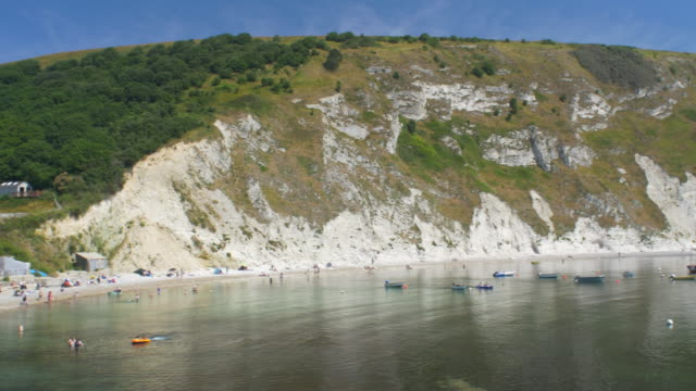 lulworth cove jurassic coast. dorset, england. - jurassic stock videos & royalty-free footage