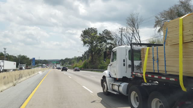 lumber loaded truck on the interstate 75 in tennessee. - forestry industry stock videos & royalty-free footage