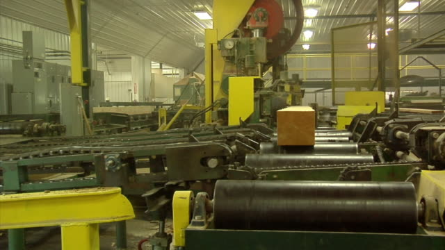 MS, Lumber moving on conveyors at sawmill, Manistique, Michigan, USA