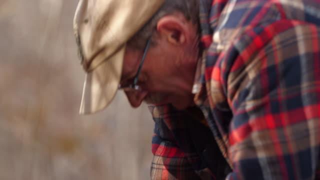 Lumberjack hits tree with hatchet