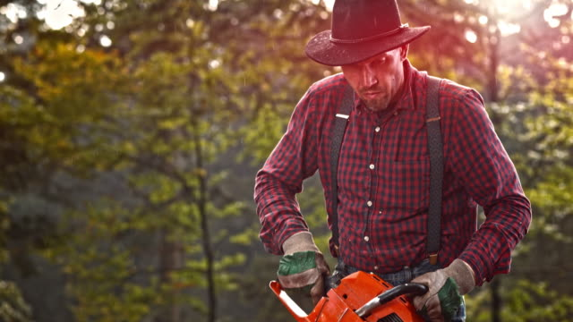 slo mo lumberjack starting a chainsaw - suspenders stock videos and b-roll footage