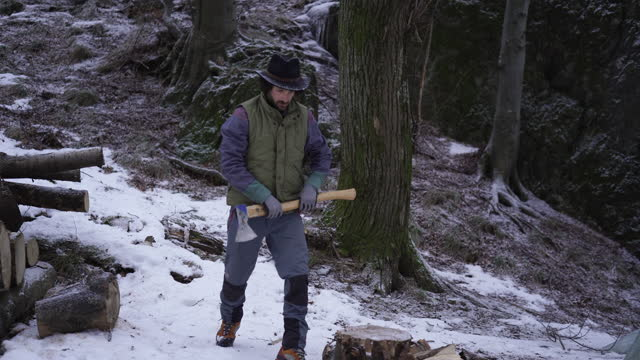 lumberjack using axe to cut wood in snowy weather - one man only stock videos & royalty-free footage