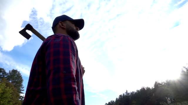 lumberjack with axe - lumberjack stock videos and b-roll footage