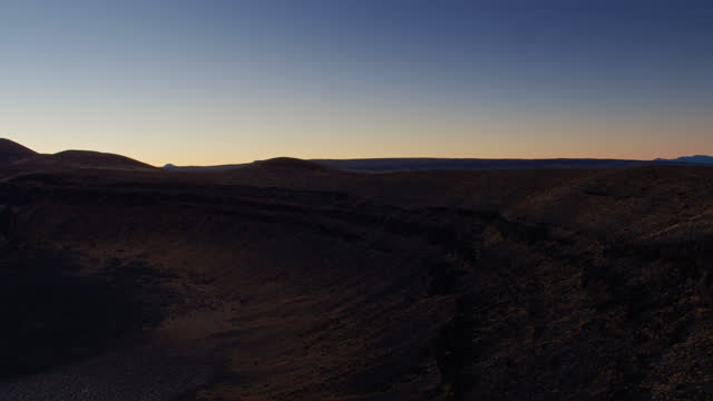 lunar crater national natural landmark at twilight - drone shot - natural landmark stock videos & royalty-free footage