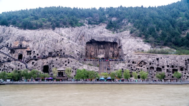 Luoyang,China-Mar 25,2018: Time lapse of the visitors at the Longmen Grottoes, Luoyang, China