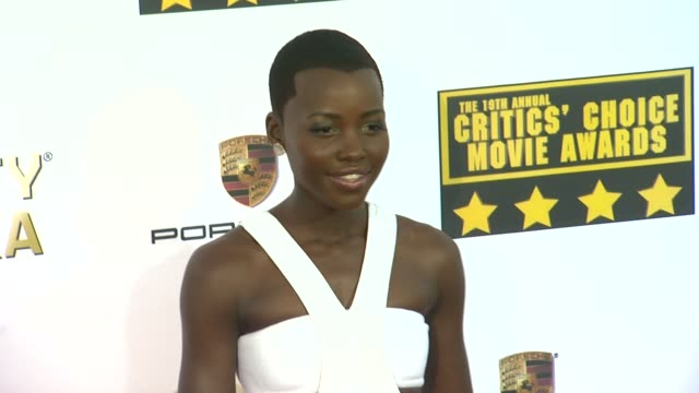lupita nyong'o at 19th annual critics' choice movie awards - arrivals at the barker hanger on in santa monica, california. - critics' choice movie awards stock videos & royalty-free footage