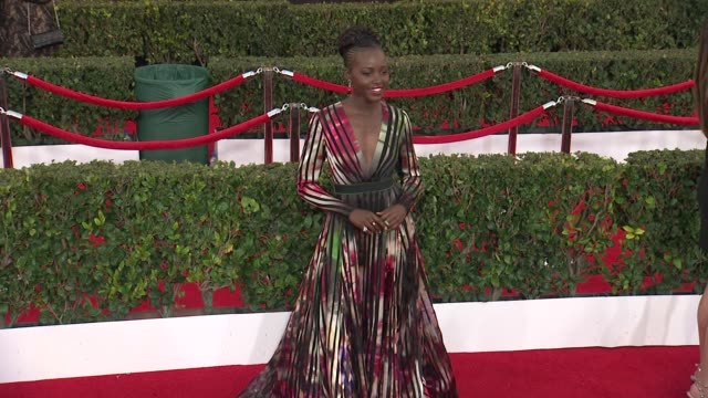 lupita nyong'o at the 21st annual screen actors guild awards - arrivals at the shrine auditorium on january 25, 2015 in los angeles, california. - shrine auditorium stock videos & royalty-free footage